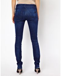 7 for all mankind cristen mid rise skinny jeans in blue. Black Bedroom Furniture Sets. Home Design Ideas