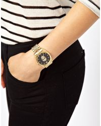 River Island Metallic Gold Skull Printed Face Watch