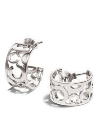 COACH - Metallic Pierced Op Art Huggie Earrings - Lyst