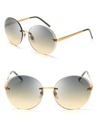 Gucci Metallic Round Rimless Sunglasses