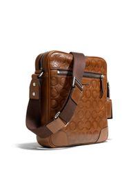 COACH Brown Bleecker Large Flight Bag in Op Art Embossed Leather for men