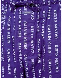 Calvin Klein Blue All Over Logo Lounge Bottoms for men