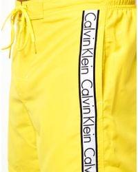 Calvin Klein Yellow Surf Swim Shorts for men