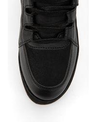 Urban Outfitters Black Yru Qozmo Tonal Hightop Flatform sneaker