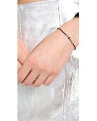 Tai - Black Delicate Cross Bracelet - Lyst