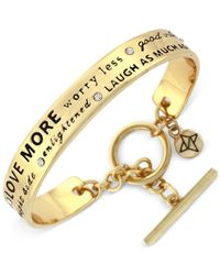 BCBGeneration | Metallic Gold-tone Optimistic Word Bangle Bracelet | Lyst
