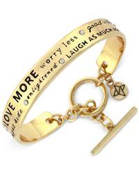 BCBGeneration | Metallic Gold-tone Optimistic Word Bangle Bracelet | Lyst