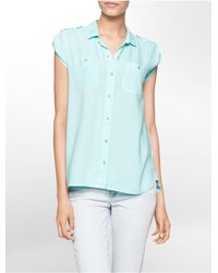 Calvin Klein | Blue Jeans High Low Utility Cap Sleeve Top | Lyst