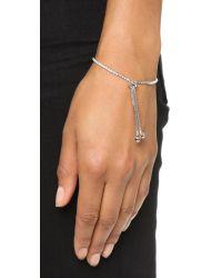 Shashi Metallic Tennis Slide Bracelet