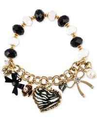 Betsey Johnson - Metallic Gold-Tone Zebra Multi-Charm And Bead Stretch Bracelet - Lyst