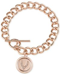 Carolee | Pink Rose Gold-tone Wishbone Toggle Charm Bracelet | Lyst