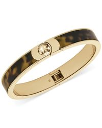 Michael Kors | Metallic Gold-Tone Tortoise Logo Bangle Bracelet | Lyst
