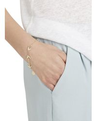 McQ | Metallic Gold Tone Swallow Bracelet | Lyst