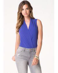 Bebe | Blue Silk Wrap Bodysuit | Lyst