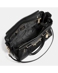 COACH - Black Swagger 27 In Pebble Leather - Lyst