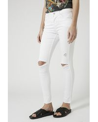 Topshop Petite Moto White Ripped Leigh Jeans in White | Lyst