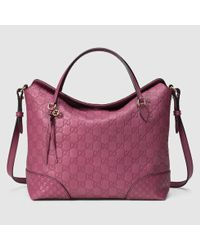 5be218d269d Lyst - Gucci Bree Guccissima Top Handle Bag in Pink
