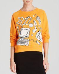 Boutique Moschino Orange Sweatshirt - Prehistoric Graphic Print