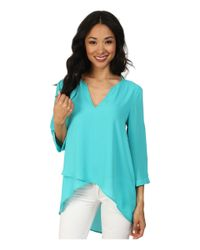 Karen Kane - Blue Asymmetrical Hem Wrap Top - Lyst