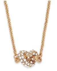 Kate Spade | Metallic Gold-tone Crystal Knot Pendant Necklace | Lyst
