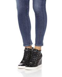 DKNY - Black Grommet Zip Wedge Sneakers - Lyst