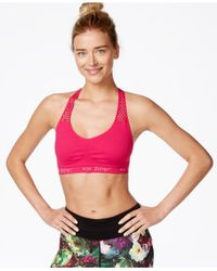 Betsey Johnson - Pink Seamless Low-impact Racerback Sports Bra - Lyst