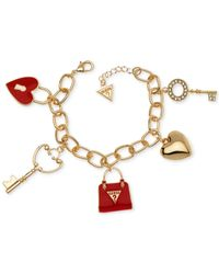 Guess | Metallic Gold-tone Crystal And Enamel Charm Gifting Bracelet | Lyst