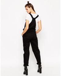 ASOS - Denim Dungaree With Tie Straps In Black - Lyst