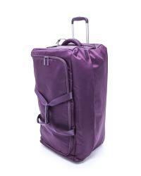 "Lipault | Purple Foldable 2 Wheeled 30"" Duffel Bag - Navy | Lyst"