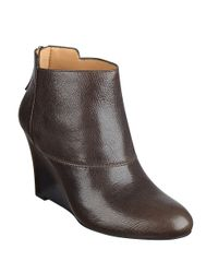 nine west optimistic leather wedge ankle boots in gray