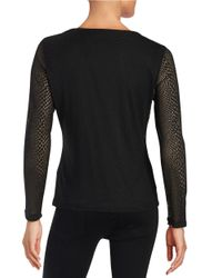 Calvin Klein   Black Sheer Animal Print Top   Lyst