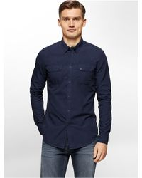 Calvin Klein - Blue Jeans Slim Fit Garment Dyed Poplin Utility Shirt for Men - Lyst