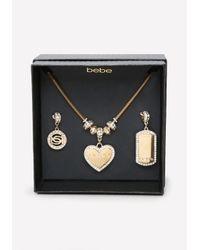 Bebe - Metallic Logo Charm Change Necklace - Lyst