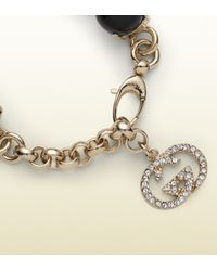 Gucci Metallic Bracelet With Crystals And Pearl Effect Glass