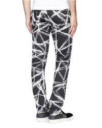 McQ Black Scratch Print Skinny Jeans for men