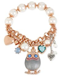 Betsey Johnson Metallic Rose Gold-tone Owl Charm And Faceted Bead Stretch Bracelet