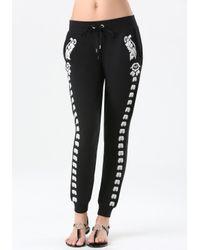 Bebe | Black Embroidered Jogger Pants | Lyst