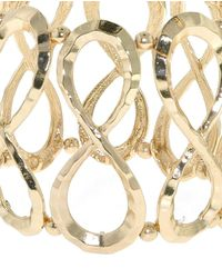1928 - Metallic Gold Hammered Infinity Stretch Bracelet - Lyst