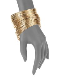 Cara | Metallic Golden Bangle | Lyst