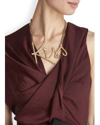 Lanvin | Metallic Gold Tone Kiss Necklace | Lyst