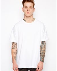 ASOS White T-shirt With Oversized Fit And Roll Sleeve for men