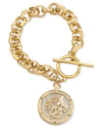 Carolee | Metallic Gold-Tone Shaky Peace Charm Bracelet | Lyst