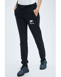 Nike Track And Field Joggers In Black