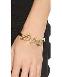 kate spade new york - Metallic Say Yes Love Bangle Bracelet - Gold - Lyst
