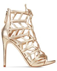 Lyst Guess Women S Anasia Lace Up Caged Gladiator