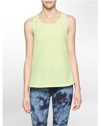 Calvin Klein - Green White Label Performance Solid High Low Tank Top - Lyst