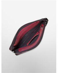 Calvin Klein - Purple Arslyne Pebble Textured Leather Large Wristlet - Lyst