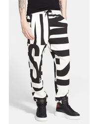 Moschino - Black Allover Print Sweatpants for Men - Lyst