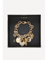 Bebe - Metallic Logo Charm Bracelet - Lyst