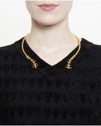 Yvonne Léon Metallic 18K Gold Fish Skeleton Necklace